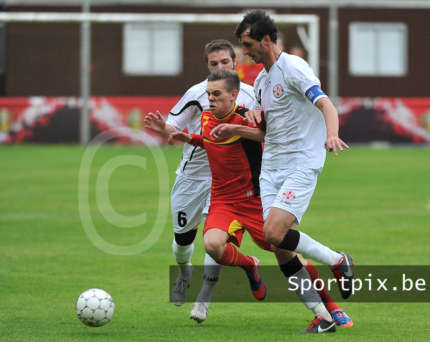Georgia U19 - Belgium U19 : Leandro Trossard (17) and Daviti Ubilava (6) with Nika Sandokhadze (4)<br /> foto DAVID CATRY / Nikonpro.be