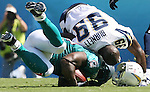 Miami's Ricky Williams is hit hard by San Diego's Kevin Burnett during the first half at Qualcomm Stadium in San Diego on Saturday, Sept. 27, 2009.