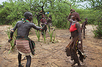 Ethiopia. Southern Nations, Nationalities, and Peoples' Region. Omo Valley. Turmi. Hamar tribe (also spelled Hamer). Pastoralist group. A Hamar man comes of age by leaping over a line of cattle. On the afternoon of the leap, as guests gather, the man's female relatives demand to be whipped as part of the ceremony. The men, who have already jumped the cattle and are known as Maza, use long thin sticks and strike girls and women on their backs. No screaming is permitted by the men wielding the canes but the women don't care. Instead of fleeing, they beg the men to do it again and again until blood flows, dripping into the gritty red dust. This is a consensual act, with girls and women begging and singing to the men, so that they continue whipping them. It is not only a show of strength from girls and women, who proudly show off their scars, but it also symbolises their affiliation and loyalty towards their kin. The scars are a mark on how they suffered for their brothers and relatives. It also a legacy of an initiation rite that sees them beaten bloody. The Omo Valley, situated in Africa's Great Rift Valley, is home to an estimated 200,000 indigenous peoples who have lived there for millennia. Amongst them are 60'000 to 70'000 Hamar, an Omotic community inhabiting southwestern Ethiopia. They live in Hamer woreda (or district), a fertile part of the Omo River valley, in the Debub Omo Zone of the Southern Nations, Nationalities, and Peoples Region (often abbreviated as SNNPR) which is one of the nine ethnic divisions of Ethiopia. 9.11.15 © 2015 Didier Ruef