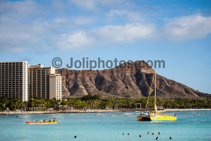 HONOLULU, Waikiki, Oahu. - (Friday, December 21, 2012) --Diamond Head at the eastern end of Waikiki Beach The tourist spot of Waikiki was busy today with Christmas holiday crowds in the water, on the sand and in the streets. Photo: joliphotos.com