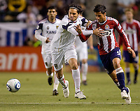 Real Salt Lake forward Fabio Espindola (7) pushes off Chivas USA midfielder Marcelo Saragosa (5) on his way to scoring the winning goal of the match. Real Salt Lake defeated CD Chivas USA 2-1at Home Depot Center stadium in Carson, California on Saturday May 22, 2010.  .