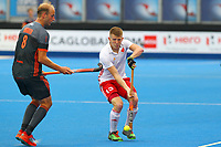 Sam Ward of England controls the ball with Netherlands Billy Bakker watching on during the Hockey World League Semi-Final match between England and Netherlands at the Olympic Park, London, England on 24 June 2017. Photo by Steve McCarthy.