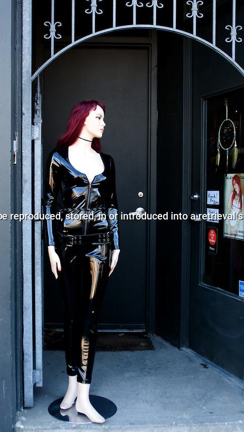 Mannequin dressed in black latex