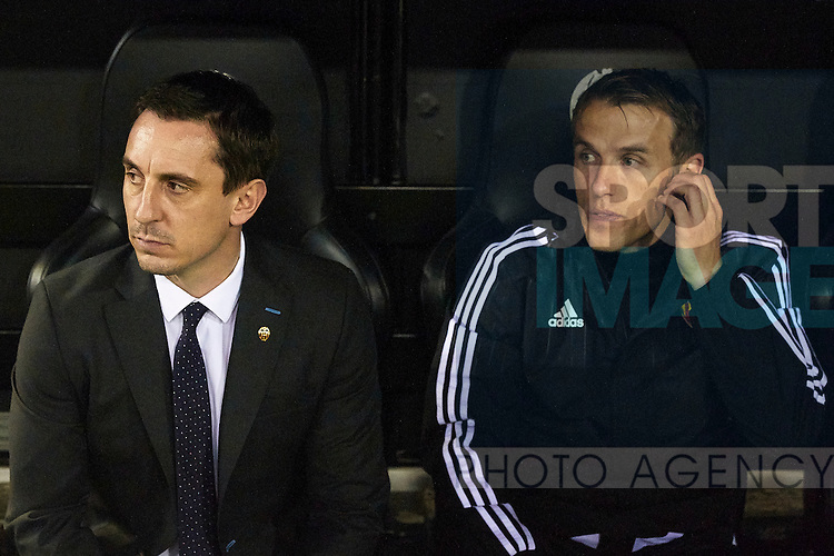 Gary Neville (L) head coach of Valencia CF and his brother Phil Neville assistant manager at the bench prior to the game - UEFA Champions League Group H - Valencia CF vs Olympique Lyonnais - Mestalla Stadium - Valencia- Spain - 09th December 2015 - Pic David Aliaga/Sportimage