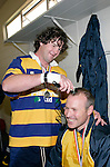 Dave Cunningham gets the first shot at shaving coach Reon Graham's head in celebration of winning the Premier final. McNamara Cup final - Premier 1 Championship, Patumahoe v Ardmore Marist. Patumahoe won 13 - 6. Counties Manukau club rugby finals played at Growers Stadium, Pukekohe, 24th of June 2006.