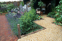 Lavender in bloom around weathered driftwood tree stump with brick path, zigzag pebble path, wooden edges, climbing vine Clematis on driftwood support, Lavandula angustifolia, climbing roses Rosa and purple clematis climbing vines on trellis by gazebo shed building, scarlet runner beans, vegetables onions, mixture of annuals, perennials, veggies, squash, flowers, chair furniture, garden tools, potting bench, pots, galvanized watering can, table, flats of plants , patio, shed building, vines, fence, home landscaping with various hardscaping materials mixed - getting rid of the lawn grass