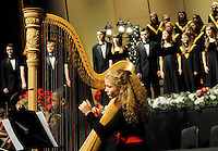 STAFF PHOTO FLIP PUTTHOFF <br /> NOEL, NOEL IN CHORUS<br /> Caroline Jorgensen, sophomore at Bentonville High School, plays harp during a performance on Saturday Dec. 6 2014 of the program Noel sung by students in the high school's various choral groups. Students put on two performances on Saturday at the Arend Arts Center on the school campus. The show featured traditional Christmas carols and lesser known carols.