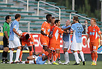 02 June 2012: A melee breaks out after a foul by Carolina's Gale Agbossoumonde (5th from the left) on Puerto Rico's Jonathan Fana (DOM) (4th from left) leading to a red card ejection on Agbosoumonde. The Carolina RailHawks defeated the Puerto Rico Islanders 2-1 at WakeMed Soccer Stadium in Cary, NC in a 2012 North American Soccer League (NASL) regular season game.