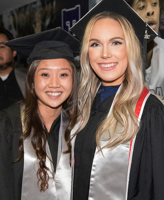 Madison LaRae Petrich (right) and Connie Voong during the University of Nevada, Reno afternoon Winter Commencement Ceremony at Lawlor Events Center in Reno, Saturday, Dec. 9, 2017.