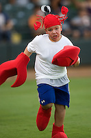 Kid in lobster costume 3705 (Andrew Woolley).jpg.  PCL baseball featuring the Oklahoma City Redhawks at Round Rock Express (in throwback Austin Senators uniforms) at Dell Diamond on July 18th 2009 in Round Rock, Texas. Photo by Andrew Woolley.
