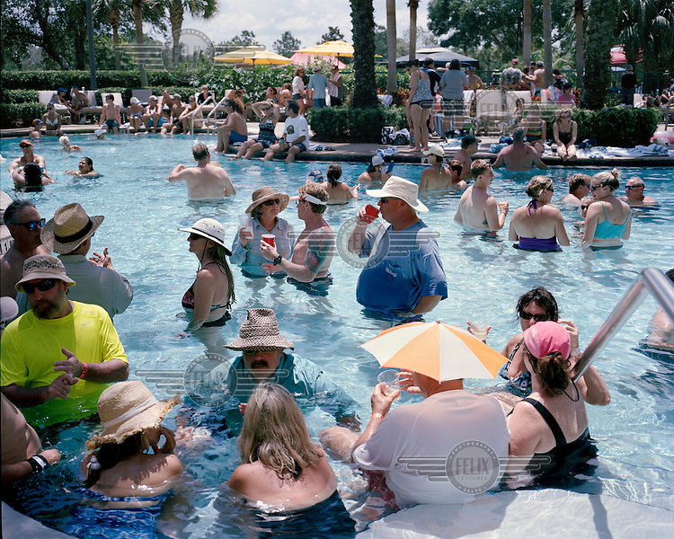 People crowd the swimming pool during the pool party at the 2013 Panama Canal Society Reunion held at the Marriott hotel in Orlando, Florida.