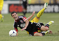 WASHINGTON, DC - AUGUST 4, 2012:  Chris Pontius (13) of DC United crashed to the turf after a tackle by Chris Birchall (8) of the Columbus Crew during an MLS match at RFK Stadium in Washington DC on August 4. United won 1-0.