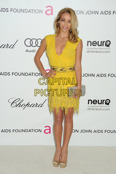 Sarah Scott.20th Annual Elton John Academy Awards Viewing Party held at West Hollywood Park, West Hollywood, California, USA..February 26th, 2012.oscars full length yellow dress gold shoes silver clutch bag hand on hip sleeveless .CAP/ADM/BP.©Byron Purvis/AdMedia/Capital Pictures.