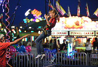 NWA Democrat-Gazette/ANDY SHUPE<br /> Madison McCoskey, 10, of Fayetteville laughs Thursday, Sept. 3, 2015, as she jumps with the aid of bungees on the Spider Jump during the Washington County Fair at the county fairgrounds in Fayetteville.
