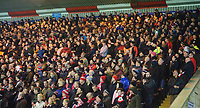 Lincoln City fans watch their team in action<br /> <br /> Photographer Chris Vaughan/CameraSport<br /> <br /> The EFL Sky Bet League Two - Lincoln City v Yeovil Town - Friday 8th March 2019 - Sincil Bank - Lincoln<br /> <br /> World Copyright © 2019 CameraSport. All rights reserved. 43 Linden Ave. Countesthorpe. Leicester. England. LE8 5PG - Tel: +44 (0) 116 277 4147 - admin@camerasport.com - www.camerasport.com