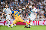 Carlos Henrique Casemiro (r) of Real Madrid competes for the ball with Agustin Farias of APOEL FC during the UEFA Champions League 2017-18 match between Real Madrid and APOEL FC at Estadio Santiago Bernabeu on 13 September 2017 in Madrid, Spain. Photo by Diego Gonzalez / Power Sport Images