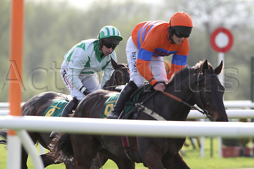 2011.04.09. Totesport Grand National Day, Bangor on Dee Racecourse. In this picture Campbell Gillies wins aboard Moufatango (France) ahead of Wayne Hutchinson on Petit Fleur.