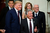 US President Donald J. Trump (L) poses for a picture with Italian-born American former racing driver Mario Andretti (R), as President of Italy Sergio Mattarella (Back R) and his daughter and Italy's First Lady Laura Mattarella (Back L) look on; during a reception in the East Room of the White House in Washington, DC, USA, 16 October 2019. US President Donald J. Trump hosted the President of Italy Sergio Mattarella and his daughter and Italy's First Lady Laura Mattarella at a reception held in honor of the Italian Republic.<br /> Credit: Michael Reynolds / CNP