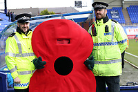A poppy poses with the local constabulary before Tranmere Rovers vs Dagenham & Redbridge, Vanarama National League Football at Prenton Park on 11th November 2017