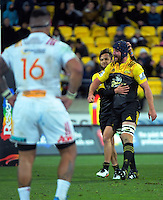 Jamison Gibson-Park congratulates Mark Abbott on his defence during the Super Rugby semifinal match between the Hurricanes and Chiefs at Westpac Stadium, Wellington, New Zealand on Saturday, 30 July 2016. Photo: Dave Lintott / lintottphoto.co.nz