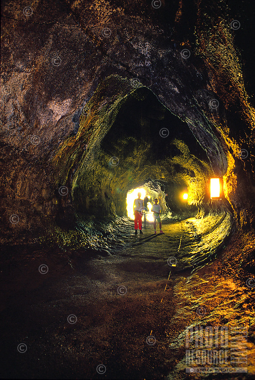 People exploring the interior of the Thurston lava tube at the Hawaii national volcano park