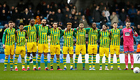 9th February 2020; The Den, London, England; English Championship Football, Millwall versus West Bromwich Albion; West Bromwich Albion starting eleven during a minutes applause before kick off for all the Millwall fans who passed away during 2019