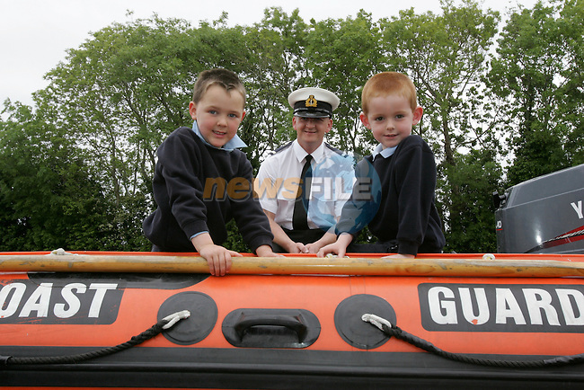 Irish Coast Guard Member Sean Duff with Students Ian Murray and Ian Fitzsimons from Duleek Boys national School..Photo: Newsfile/Fran Caffrey..The summer is here and the Drogheda Coast Guard Unit are back visiting the local Primary Schools for their Annual Water Safety Talk..This has been a very successful campaign over the last four years; we have educated thousands of children in all aspects of Water Safety form the Louth and Meath Areas..We introduce the children to the basic dangers that they are likely to encounter when visiting the seaside, lakes and rivers. We also teach them the Safe Swimming Guide..We demonstrate the wearing of Lifejackets and Buoyancy Aids, how to get help if the find someone in trouble in the water, at the seaside or near cliffs..We also demonstrate the equipment that the Coast Guard wear and use in different areas of operations..The children are then brought into the schoolyard where we show them one of our Coast Guard Boats and all Life Saving Equipment on board..Last year we visited thirty schools reaching approx. three thousand children..We wish everyone a warm and happy summer..Enjoy our local waterways and coast, always read signs, stay alert and beware of any dangers..If you see any one in difficulty in our local Rivers, Lakes or along our Coast, Call 112 or 999 and ask for the Coast Guard...Dermot Mc Connoran .Area Officer .Drogheda Coast Guard...