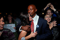 DENVER - NOV 6: Colorado Democrats Jessica English, left, and Harold Jobson, right, embrace as they react to the announcement that President Obama has won the 2012 election at the Sheraton Hotel in Denver, Colorado, on Tuesday, November 6, 2012. (Photo by Landon Nordeman)