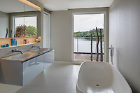 The elegant free-standing tub is situated to allow a view to the lake beyond when relaxing in the bath.