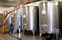 Domaine Haut-Lirou in St Jean de Cuculles. Pic St Loup. Languedoc. Stainless steel fermentation and storage tanks. Floating top vats. France. Europe.