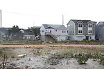 One remaining damaged home from Super Storm Sandy still sits next to new homes recently constructed in Ortley Beach, New Jersey where Super Storm Sandy wiped out whole blocks of homes 5 years ago. (Bill Denver For New York Daily News)
