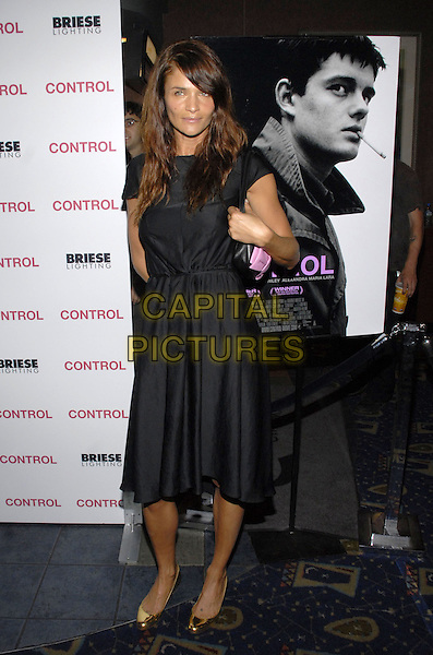 "HELENA CHRISTENSEN.New York premiere of The Weinstein Company's ""Control"" held at Chelsea West Cinema, New York City, New York, USA..September 25th, 2007.full length black dress gold shoes .CAP/ADM/BL.©Bill Lyons/AdMedia/Capital Pictures. *** Local Caption ***"