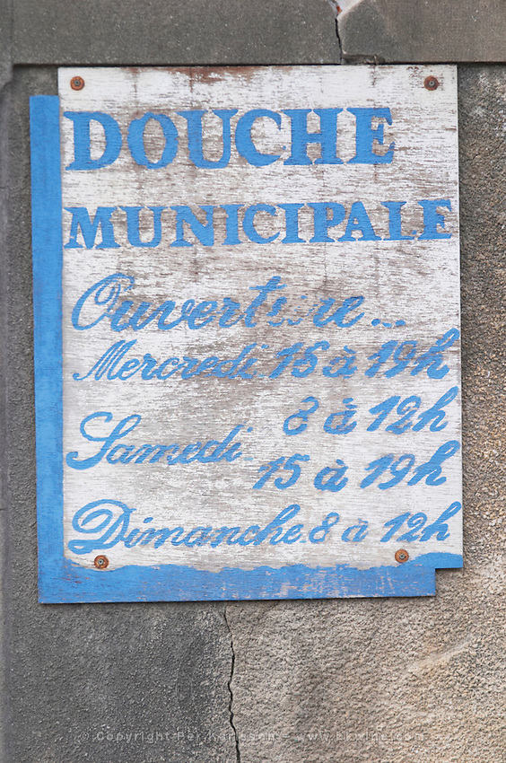 Municipal showers old sun bleached sign, open on Wednesdays, Saturdays and Sundays. Town of Limoux. Limoux. Languedoc. France. Europe.