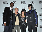 BEVERLY HILLS, CA. - October 13: Snoop Dogg, Producer Larry Klein, Paula Abdul and Adam Lambert attend the 2009 American Music Awards Nomination Announcements at the Beverly Hills Hotel on October 13, 2009 in Beverly Hills, California.