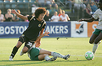 Eriko Arakawa (30) follows the ball after Stephanie Logterman's slide tackle. FC Gold Pride tied the St. Louis Athletica 1-1 at Buck Shaw Stadium in Santa Clara, California on August 9, 2009.