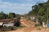 Pará State, Brazil. São Félix do Xingu. Unpaved street with church at the end.