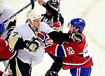 6 February 2010: Pittsburgh Penguins' defenseman Mark Eaton (7) scuffles with Montreal Canadiens center David Desharnais (58) during the first period at the Bell Centre in Montreal, Quebec, Canada. The Canadiens defeated the Penguins 5-3. Mandatory Credit: Ed Wolfstein Photo