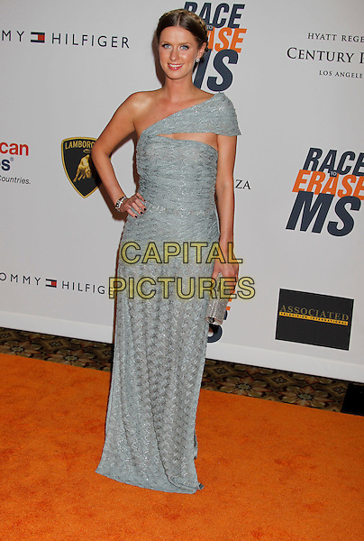 NICKY HILTON .17th Annual Race To Erase MS. Held at the Hyatt Regency Century Plaza Hotel,   Century City, California, USA, .May 7th 2010..full length long maxi dress bracelet hand on hip clutch bag green grey gray silver one shoulder cut out knitted eyeliner earrings studs smiling .CAP/ADM/MJ.©Michael Jade/AdMedia/Capital Pictures.