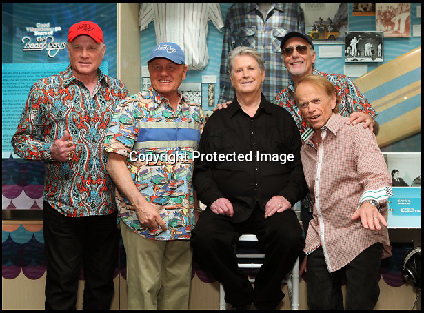 BNPS.co.uk (01202 558833)<br /> Pic: RockawayRecords/BNPS<br /> <br /> ****Please use full byline****<br /> <br /> The Beach Boys at the Grammy Museum.<br /> <br /> A surfboard belonging to legendary Beach Boys drummer Dennis Wilson which featured on the covers of two of their most famous albums has emerged for sale for &pound;100,000.<br /> <br /> The iconic blue and yellow board was used for the cover of the Beach Boys' groundbreaking debut album, 1962's Surfin' Safari, and again in 1963 on the front of Surfer Girl.<br /> <br /> Wilson, the band's only surfer, brought the 9ft board along to the band's first ever professional photo shoot held on a beach in California in 1962 shortly after they signed with Capitol Records.<br /> <br /> The five members - Brian, Dennis and Carl Wilson, their cousin Mike Love and friend Al Jardine - were snapped holding it while striking various poses on a beach. The photos from the session went on to become some of the most iconic images of the band.<br /> <br /> Wilson gave the board to his close friend Louis Marotta in the 1970s who in turn passed it on to Beach Boys fan Bob Stafford in 1985.<br /> <br /> Mr Stafford is now selling the board with a whopping price tag of &pound;100,000 after a short stint on display at the Grammy Museum in Los Angeles to mark the band's 50th anniversary.