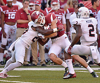 STAFF PHOTO BEN GOFF  @NWABenGoff -- 09/20/14 <br /> Arkansas wide receiver Cody Holister takes a hit from Northern Illinois cornerback Paris Logan during the first quarter of the game against Northern Illinois in Reynolds Razorback Stadium in Fayetteville on Saturday September 20, 2014.