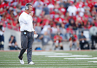 Ohio State Buckeyes head coach Urban Meyer speaks into his headset in the second quarter of the college football game between the Ohio State Buckeyes and the Northern Illinois Huskies at Ohio Stadium in Columbus, Saturday afternoon, September 19, 2015. The Ohio State Buckeyes defeated the Northern Illinois Huskies 20 - 13. (The Columbus Dispatch / Eamon Queeney)