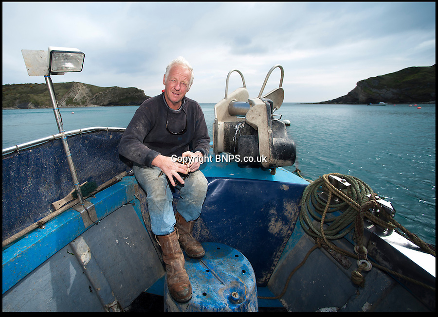 BNPS.co.uk (01202) 558833<br /> Picture: Peter Willows<br /> <br /> Father Joe on  'Near Enough'.<br /> <br /> All at sea - In a fast changing world the Dorset fishing family still going strong after 350 years.<br /> <br /> Young Levi Miller is ensuring the survival of his family's 350-year-old seafaring tradition - by becoming it's tenth generation of Dorset fisherman. The 16-year-old's ancestors have been fishing off the Dorset coast since Henry Miller first set sail in the 1670s. <br /> <br /> Levi has now become the latest family member to choose a life on the waves and has begun learning the trade onboard his father's fishing boat. Levi got hooked on fishing as a child and despite only just finishing school, he says there is nowhere else he would rather be than hauling in fish alongside his dad and to play his own part in his family's historic trade.