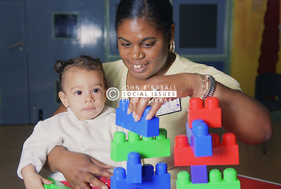 Family support worker playing with child,