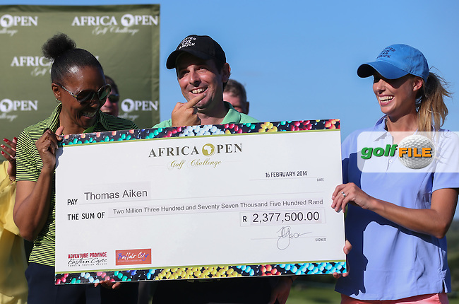 Champion golfer Thomas Aiken (RSA) receives his winning cheque with wife Kate expecting 10% at The Africa Open 2014 at the East London Golf Club, Eastern Cape, South Africa. Picture:  David Lloyd / www.golffile.ie