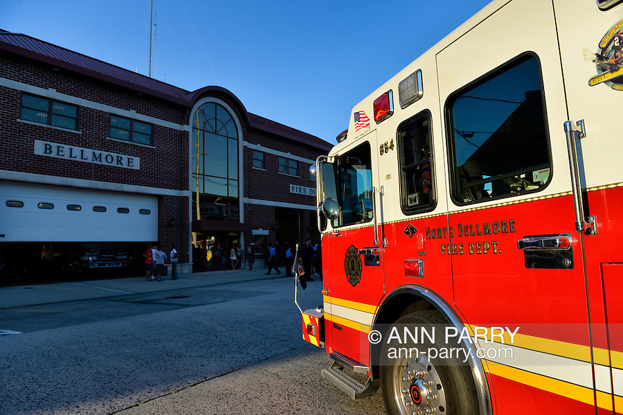 Bellmore, New York, USA. September 11, 2015. A North Bellmore Fire Dept. fire engine is parked in front of the Bellmore Fire House during the Bellmore Memorial Ceremony for 3 Bellmore volunteer firefighters and 7 residents who died due to 9/11 terrorist attack at NYC Twin Towers. Bellmore volunteer firefighters Lt. Kevin Prior and F.F. Adam Rand died on 9/11/2001, and F.F. Sean McCarthy died in 2008 due to illness related to working at scene of attack.