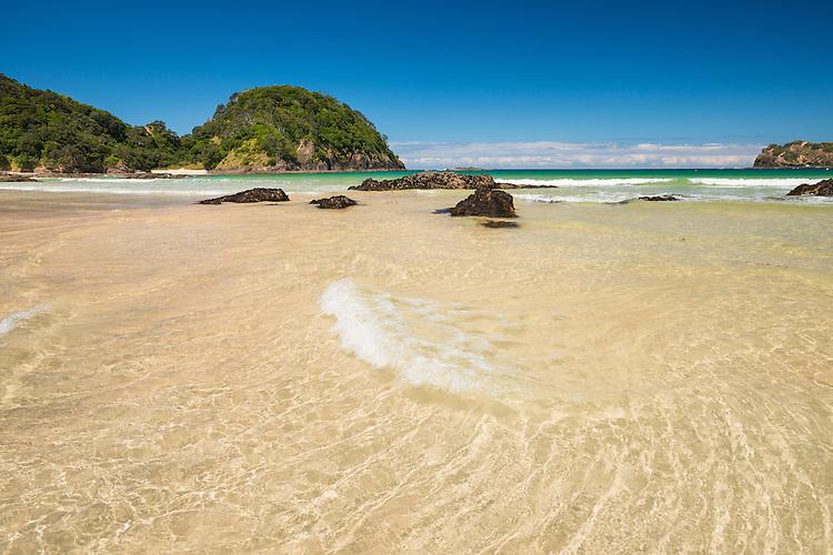 Gentle waves across golden sand,summer day  at Matapouri Bay on the Tutukaka Coast, Northland, New Zealand - stock photo, canvas, fine art print