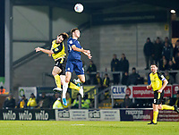 3rd December 2019; Pirelli Stadium, Burton Upon Trent, Staffordshire, England; English League One Football, Burton Albion versus Southend United; Nathan Broadhead of Burton Albion and Tom Hopper of Southend United jump up together to head the ball in the air - Strictly Editorial Use Only. No use with unauthorized audio, video, data, fixture lists, club/league logos or 'live' services. Online in-match use limited to 120 images, no video emulation. No use in betting, games or single club/league/player publications