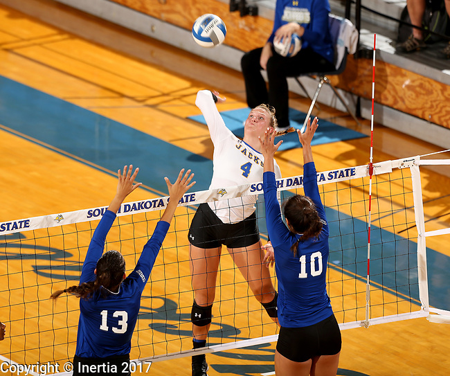 BROOKINGS, SD - SEPTEMBER 1: Ashlynn Smith #4 from South Dakota State University tries to get a kill past Sydney Haynes #13 and Briannah Mariner #10 from CSU Bakersfield during their match Friday night at the Jackrabbit Invitational at Frost Arena in Brookings. (Photo by Dave Eggen/Inertia) (Photo by Dave Eggen/Inertia)