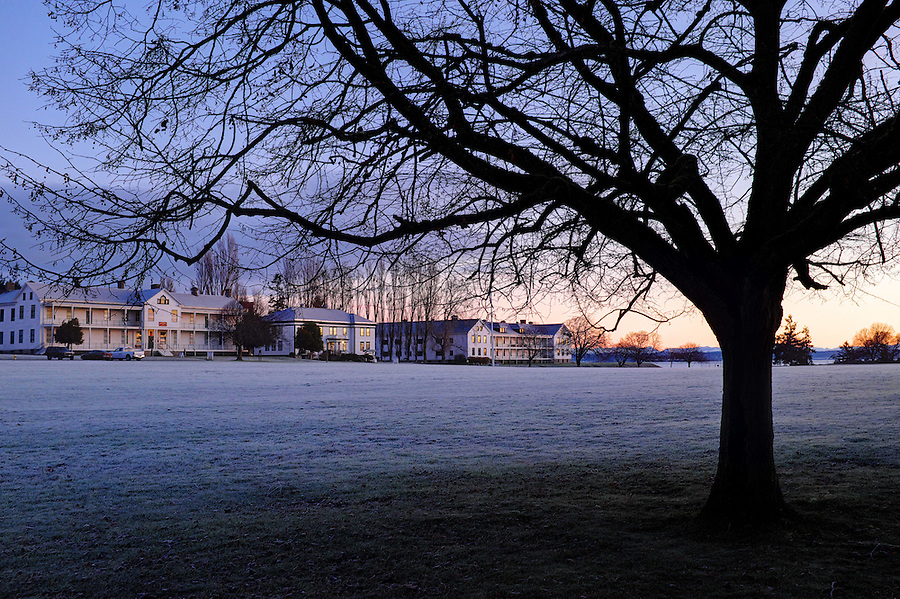 Dawn rises over frosty parade grounds old headquarters barracks, park offices and Coast Artillery Museum at Fort Worden State Park, Port Townsend, Washington, USA