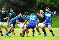 Action from the Village Kings 10s rugby tournament  match between Wainuiomata Samoan (blue and green) and Faleata (green and white) at Porirua Park in Porirua, New Zealand on Saturday, 21 October 2017. Photo: Dave Lintott / lintottphoto.co.nz